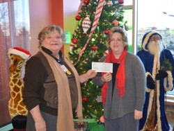 Proceeds from one of Milligan College's two Christmas concerts were presented to Niswonger Children's Hospital. Cookie McKinney (left) accepts the donation from Dr. Kellie Brown, chair of Milligan's music area. Additional proceeds will benefit Milligan's music area.